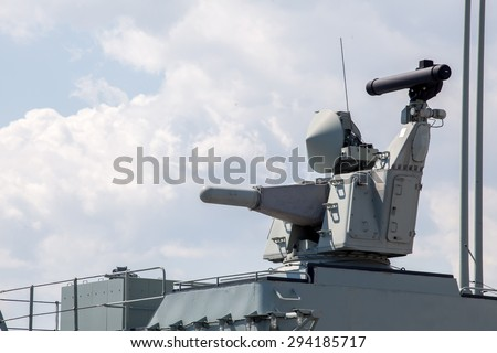 Modern weapons on the deck of a military ship. Weapon system for defense - stock photo
