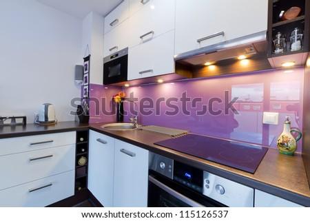 Modern white and purple kitchen interior - stock photo