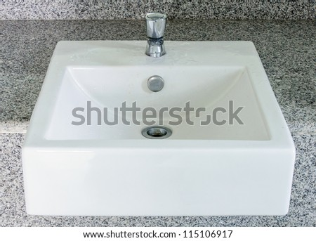 Modern white basin in the restroom of hotel. - stock photo