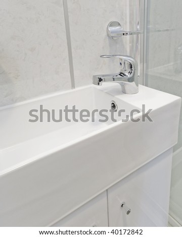 modern white ceramic hand wash basin - stock photo