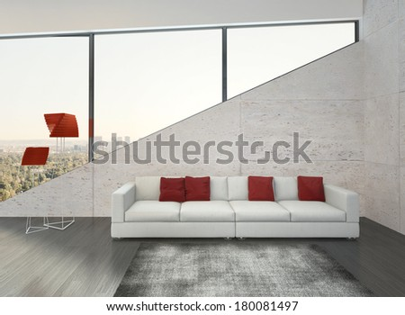Modern white couch with red pillows against stone wall - stock photo