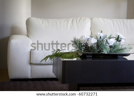 modern white floral centerpiece in contemporary living room for christmas - stock photo