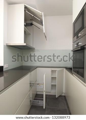Modern white kitchen cabinets - stock photo