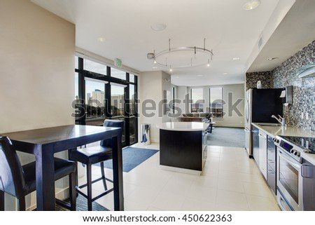 Modern white kitchen connected to living room. Apartment interior  - stock photo