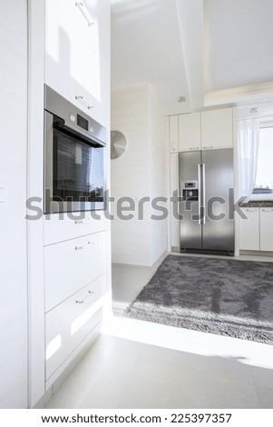 Modern white kitchen interior with advanced technology - stock photo