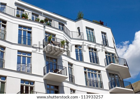 Modern white townhouse - stock photo