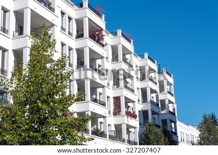 Modern white townhouses seen in Berlin, Germany - stock photo