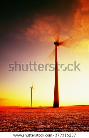 Modern Wind Turbines Producing Energy in sunny spring morning. Vintage Style Toned effect - stock photo