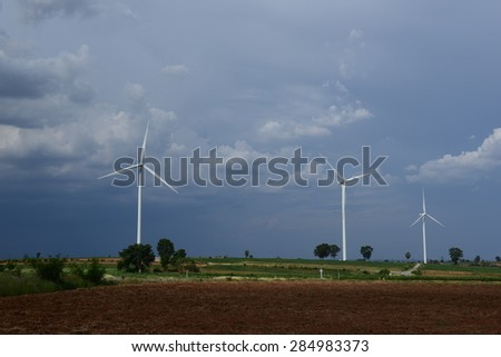 Modern windmills generate electric power along contry, Korat Thailand - stock photo