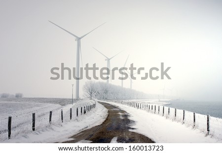 modern windturbines outside during wintertime  - stock photo