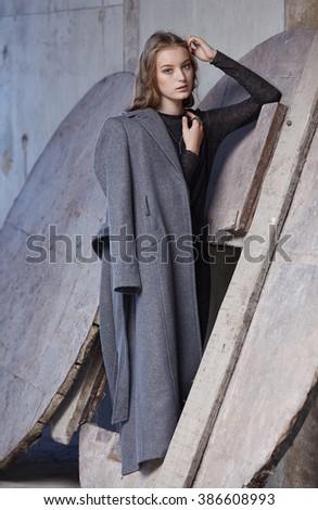 Modern woman in a grey coat. - stock photo