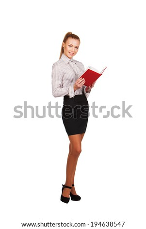 modern woman with red book in hands  full growth - stock photo