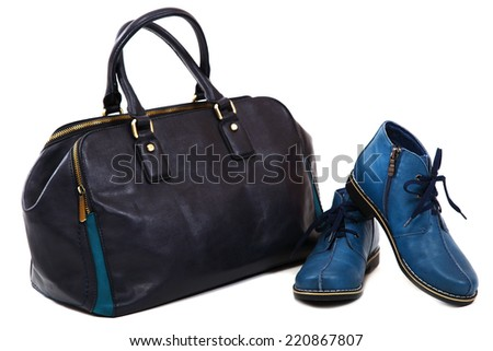 Modern women's fashion footwear and bag isolated against white background. - stock photo