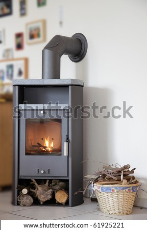 modern wood burning stove inside cozy living room - stock photo