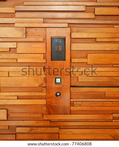 modern wood texture pattern with elevator button - stock photo