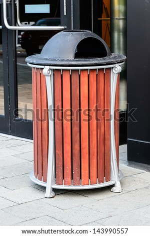 Modern wood trash bin - stock photo