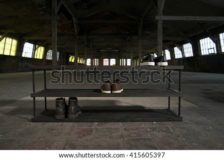 modern wooden shoe rack in the loft interior  - stock photo