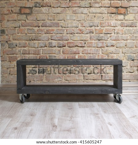 modern wooden tv unit in the loft interior  - stock photo