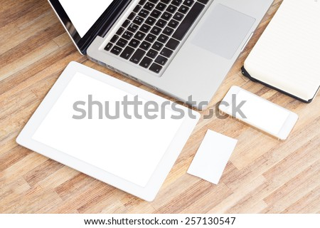 Modern working place with empty c tablet, phone  and  notebook - stock photo