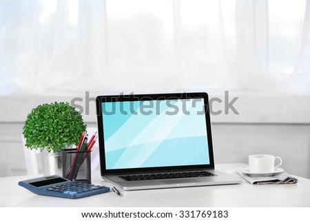 Modern workplace with laptop, close up - stock photo
