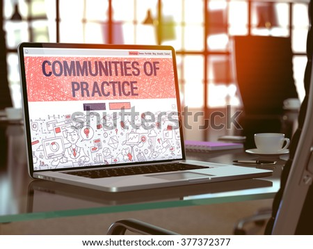 Modern Workplace with Laptop showing Landing Page in Doodle Design Style with text Communities Of Practice. Toned Image with Selective Focus. 3d Render. - stock photo