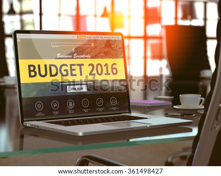 Modern Workplace with Laptop showing Landing Page with Budget 2016 Concept. Toned Image with Selective Focus. - stock photo