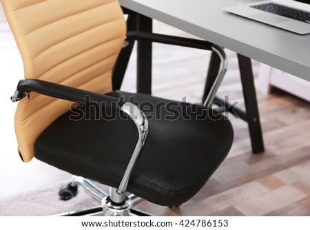 Modern workplace with office chair - stock photo
