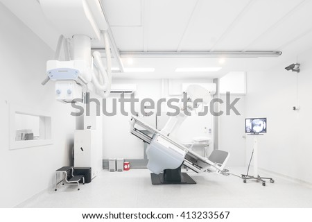 Modern x-ray machine and Computerized Axial Tomography scanning and diagnostic medical equipment in the operating room data center - stock photo