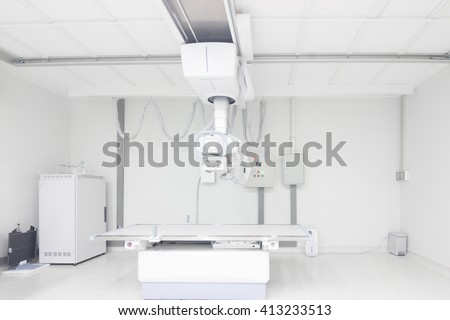Modern x-ray machine and Computerized Axial Tomography scanning and equipment in the operating room data center - stock photo