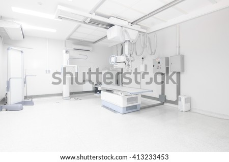 Modern x-ray machine and Computerized Axial Tomography scanning and medical equipment in the operating room data center - stock photo