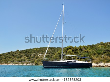 modern yacht moored in the abandoned bay  - stock photo
