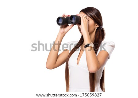Modern young business woman with binoculars in hand. Watching through binocular for the purpose of business. Woman with binoculars isolated on white. Worker looking through binocular. Space for text.  - stock photo