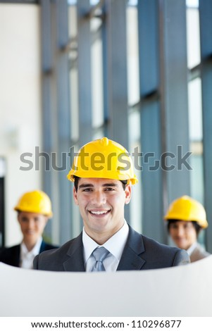 modern young male architect and co-workers in office - stock photo