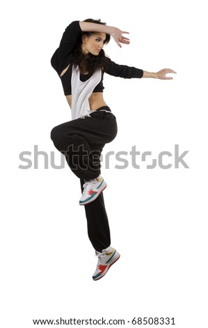 modern young woman dancer in hip hop style taking pose and  jumping over white background - stock photo