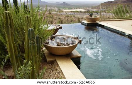Modern zero horizon swimming pool - stock photo