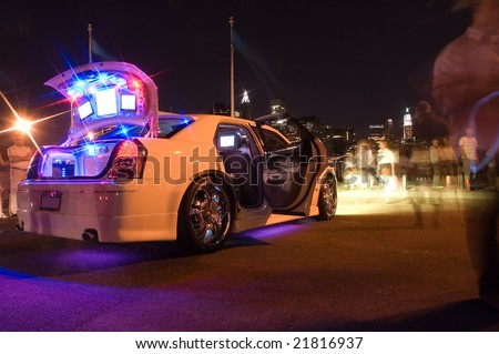 modified white car with several lights and LCD displays - stock photo