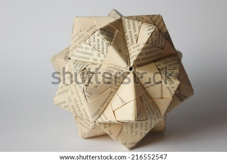 Modular origami ball made from old russian book - stock photo