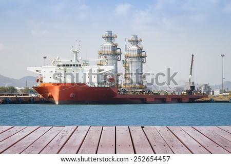 Module tank on ship in sea. - stock photo