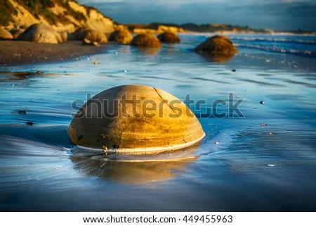 Moeraki boulders at summer sunrise, Otago, New Zealand - stock photo