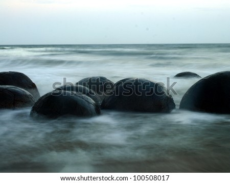 Moeraki boulders at sunset, New Zealand - stock photo