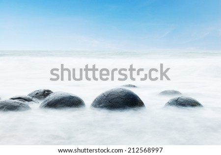 Moeraki Boulders on the Koekohe beach, Eastern coast of New Zealand.  - stock photo