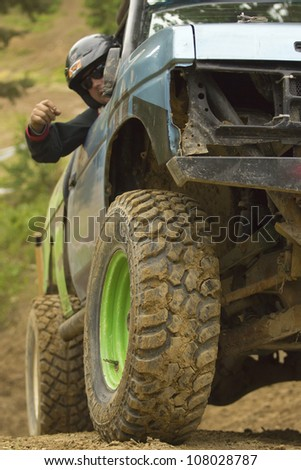"MOHELNICE, CZECH REPUBLIC - JUNE 10. Unidentified passenger at off-road car on a steep slope in the ""SHOCK CUP Trial 2012"" on June 10, 2012 in the town of Mohelnice, Czech Republic. - stock photo"