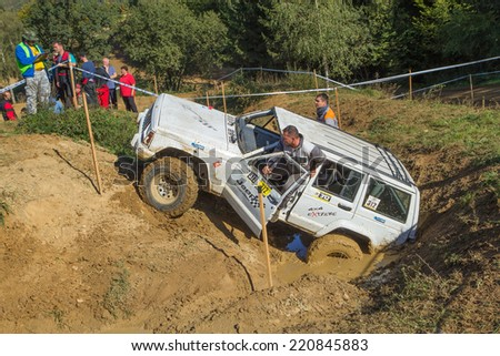 "MOHELNICE,  CZECH REPUBLIC - SEPT 28: The crew of ""drowned"" white off road car in the BIG SHOCK! CUP of the Czech Republic. On September 28, 2014  in MOHELNICE, Czech Republic.  - stock photo"