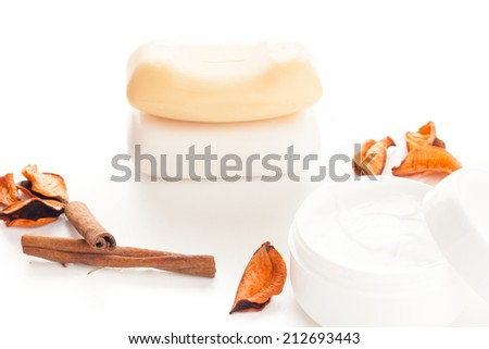 moisturizer beauty cream and soaps with flower petals - stock photo