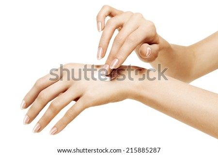 moisturizer cream on beautiful female hands isolated on a white background - stock photo