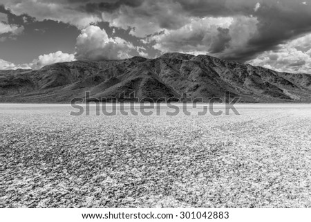 Mojave desert dry lake salt flat black and white. - stock photo