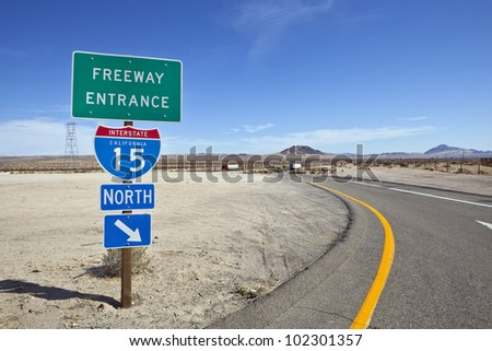 Mojave desert freeway and interstate 15 sign near Baker California. - stock photo