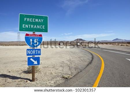 Mojave desert freeway and interstate 15 sign near Baker California. - stock photo