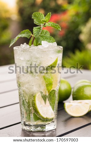Mojito a Cuban cocktail made with cuban rum, lime, sugar and a splash of soda - stock photo