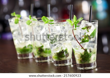 Mojito cocktail on a bar counter - stock photo